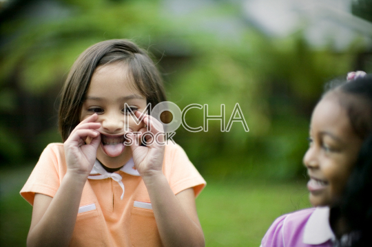 Young girl makes a funny face