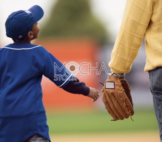 Young baseball player reaches for baseball glove