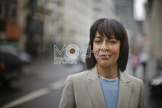 Portrait of a businesswoman on a city street