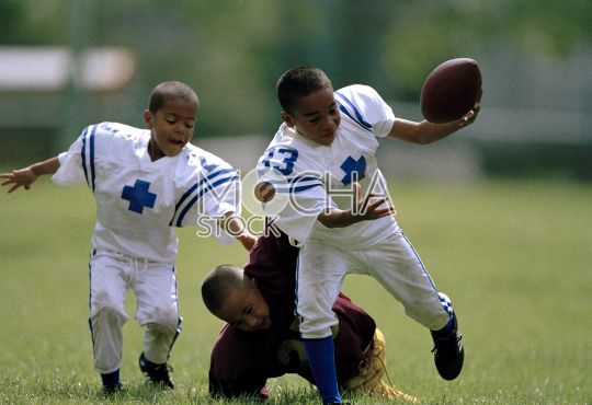 Young boys playing American Football