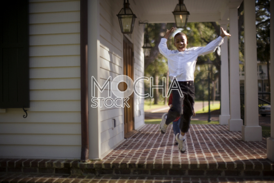 Boy running and jumping off steps