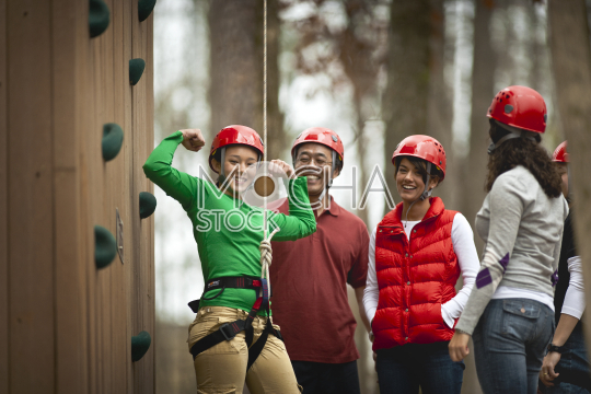 Group of teenage girls learning how to climb