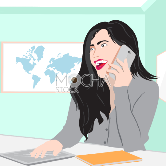 Cheerful young businesswoman sitting at her workplace