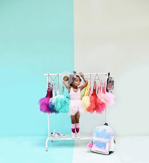 Cute Little Ballerina in a Tutu and Tennis Shoes